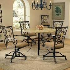 casual dining chairs with casters: brookside round dining table with oval fossil accent caster chairs by hillsdale furniture