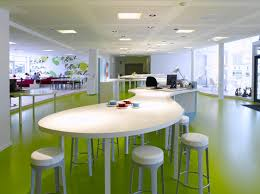 picturesque office decoration with oval meeting table and lime green painted floor and white bar stools awesome office furniture ideas