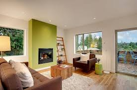 green wall living room  stylish living room with a green accent wall design limelite developm