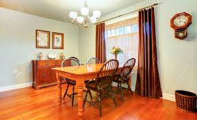 Light Tones Dining Room With Wood Dining Table Set Rustic Wall - Dining room cabinets for storage