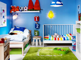 blue themed kids room for boys with sporty accent and green rug playroom ideas with blue pendant lamp blue themed boy kids bedroom