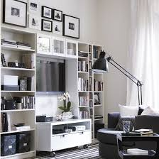 storage solutions living room: black and white room with wall shelving