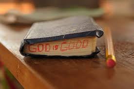 A Bible with the words God is good written on it