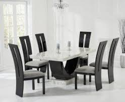 black and white dining table set: raphael cm cream and black pedestal marble dining table with