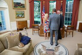 president oval office a young boy face plants onto the sofa in the oval office as bill clinton oval office rug