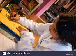 a young girl does her math homework to get good grades in school a young girl does her math homework to get good grades in school salais was photographed 12feb08 in north hills calif