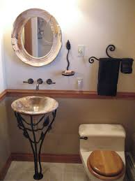 decoration bathroom sinks ideas:  elegant unique bathroom sinks with carving vessel wrought iron buffer and round carving mirror design ideas for small bathroom