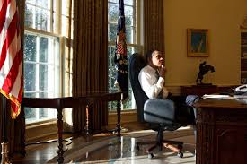 president barack obama in the oval office on his first day in office in 2009 barack obama enters oval