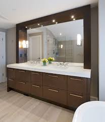 view in gallery sleek and stylish modern bathroom vanity sparkles thanks to well placed lighting above mirror lighting bathrooms