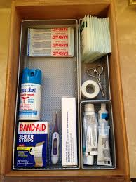 bathroom drawer organization: toothpaste drawer on left now houses extra do q tips carmex floss toothbrush covers sunscreen sticks and a couple of small toothpastes that will