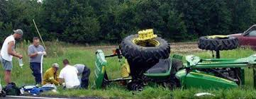 Image result for tractor tipped over