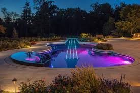 amazing and beautiful custom swimming pool in violin shape by cipriano landscape design beautiful lighting pool