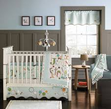 classic interior bedroom black wooden crib with mickey mouse baby nurseery bedding with blue hanging toys and laundry basket with geometric crib bedding baby mickey crib set design
