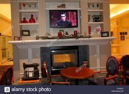 decor design hilton: maine freeport hilton garden inn motel hotel lobby fireplace decor decoration flat screen panel tv