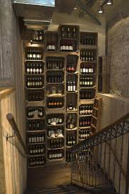 creative wine cellar solution design using stacked boxes wine racks in stairs way illuminating box version modern wine cellar