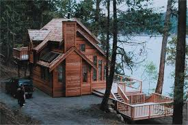 The Cabin Style House Plan Brings Luxury to Rustic LivingWith its wraparound porch and decks on both levels  this  story   bedroom Cabin house plan  left  takes in all the wonderful views of the natural