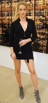 england style steps: leggy lady ellie goulding showed off her long legs in a little black dress at