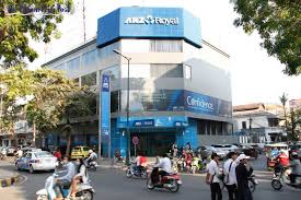traffic passes one of anz royal banks branches in phnom penhs daun penh district earlier this year vireak mai anz office melbourne