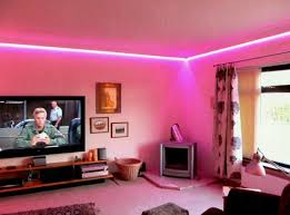 hot pink led light in modern lighting design and wide flat television on simple wooden black fabric lighting