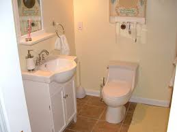 small bathroom clock: bathroom compact white vanity set design also two piece toilet and simple small bathroom remodel