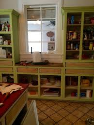 st charles kitchen cabinets: cabinet base painted with dixie belle paint limeade