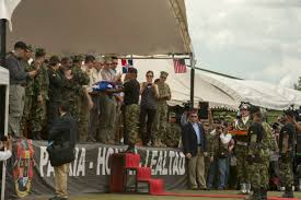 u s department of defense photo essay a n special forces ier presents u s defense secretary chuck hagel an american flag after