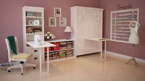 feminine work space present white twin size murphy wall bed on closed position integrated with desk awesome murphy bed office