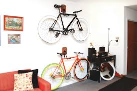 storage solutions living room: perfect wooden wall hook offering bicycle storage solutions in your living room