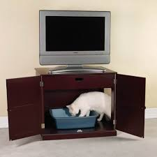 or you might invest in a classy mahogany cabinet with a secret cat litter box furniture 2