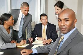 Image result for image of an black africa manager with employee in the office