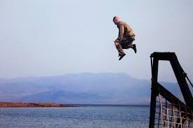 u s department of defense photo essay u s marine gunnery sgt richard mostoller leaps from an obstacle during a water obstacle course
