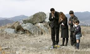 Image result for pictures of people praying at a disaster