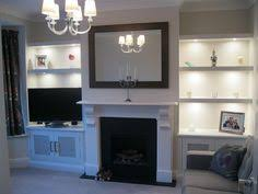 fretwork doors for entertainment remote infra red with floating shelves and integrated lighting alcove lighting ideas