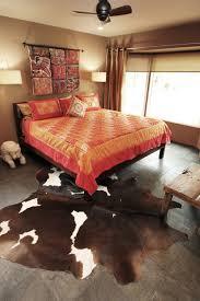 animal hide rugs bedroom eclectic with animal hide rug bed black slate floor ceiling fan animal hide rugs home office traditional