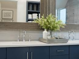 pics of bathroom designs: blue double vanity with modern hardware