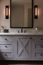 oil rubbed bronze black bathroom sink  with gray x doors adorned with star knobs topped with calcutta marble