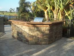patio outdoor stone kitchen bar: outdoor kitchen if you like to host outdoor parties add some detail to your outdoor patio with stone veneer on the outside of the outdoor kitchen