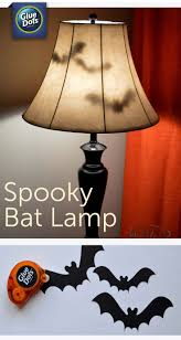 ideas outdoor halloween pinterest decorations: make a bat lamp halloween decoration for your home with paper bats and removable gluedots