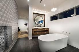 bathroom place vanity contemporary: narrow contemporary bathroom with mounted vanity cabinets and round mirrors