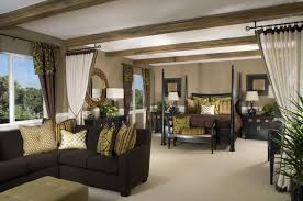 couch bedroom sofa: a bright and airy master bedroom split into two visually distinct areas via the use of