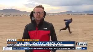 Man naruto runs behind reporter as people arrive near Area 51 ...