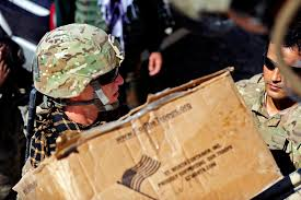 u s department of defense photo essay orphanage u s army cpl jacob bath left transports care packages during a to