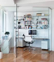 this apartment features a glass enclosed home office space that keeps sound out but natural lighting home office