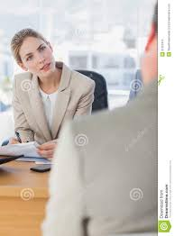 smiling businessw looking at interviewee royalty stock smiling businessw looking at interviewee