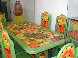 another example above of a carved and painted bench the photos below show carved and brightly painted tables and chairs bright painted furniture