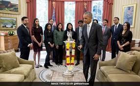 barack obama celebrates diwali lights first ever diya in oval office barack obama oval office