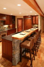oak kitchen cabinets gloss accents island comprised of stone wall and rich wood paneling matching the cab