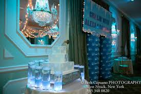 winter theme candle lighting table has vases filled with crystal chips lights and floating candles candle lighting ideas