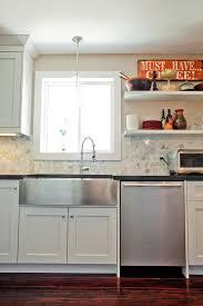 stainless steel farmhouse sink kitchen eclectic with black granite brick wall apron kitchen sink kitchen