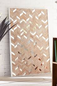mirror wall decor circle panel: pier  metro mirrored wall panel handcrafted and hand painted by indonesian artisans it boasts a bold chevron pattern of wooden zigs and mirrored zags
